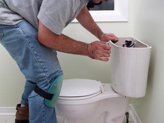 Plumbing contractor in San Bruno repairs a toilet's ballcock assembly